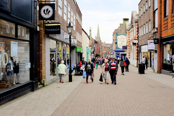South Street, Dorchester, Dorset, UK. Dorchester, Dorset, UK. May 16, 2018. Locals and tourists shopping and browsing on South street at Dorchester in Dorset, UK. south street seaport stock pictures, royalty-free photos & images
