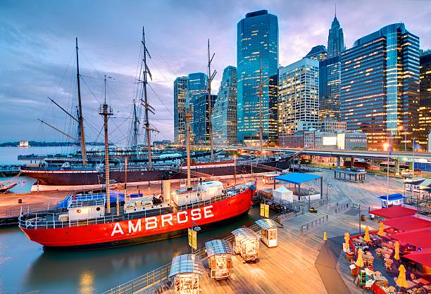 South Street Seaport New York City, USA - May 22, 2012: South Street Seaport is a designated historic district containing the largest concentration of 19th century landmarks in the city. south street seaport stock pictures, royalty-free photos & images