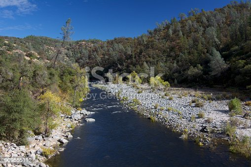 Overview of the South Yuba River at Bridgeport in the fall, featuring some yellow lea