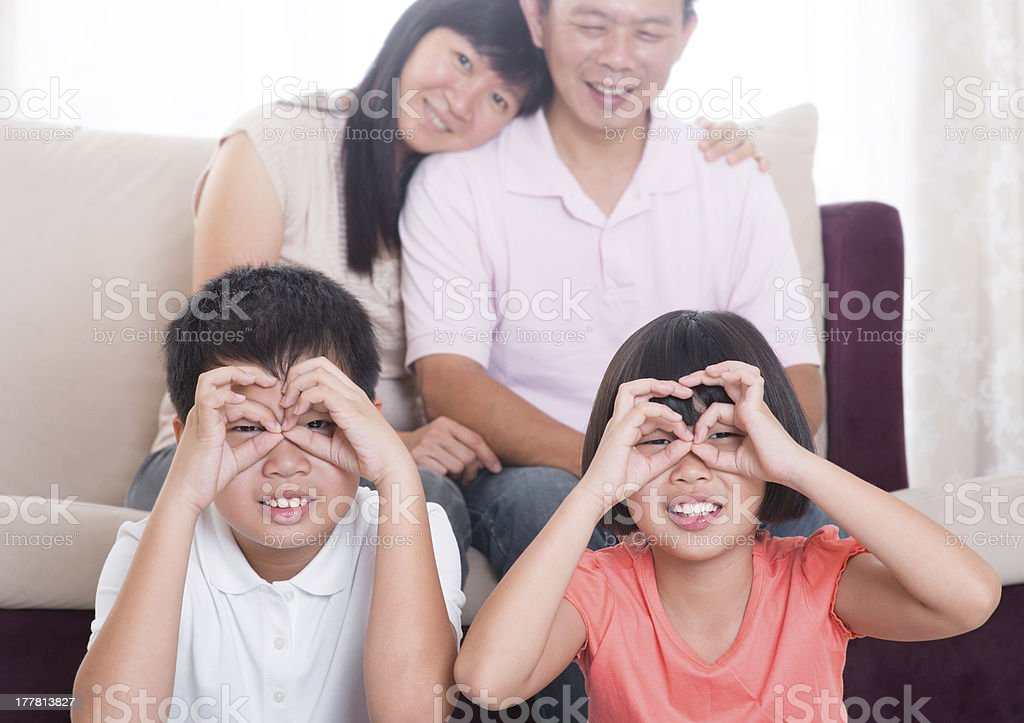 Southeast Asian family at home royalty-free stock photo