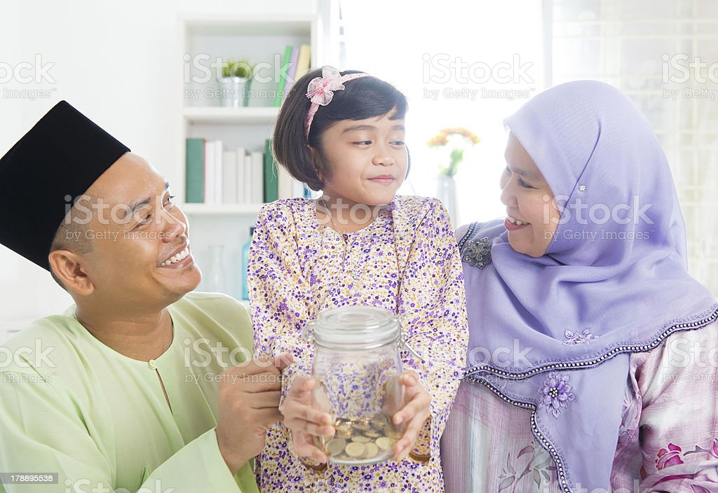 Southeast Asian Malay family saving money stock photo