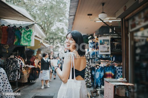Thailand, Bangkok, hipster, smiling, excitement, one person, shopping, day, relaxation, walking, cheap, street market, lifestyles, famous place, looking at camera