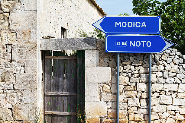 southeast sicily: roadway and road signs, modica and noto - noto sizilien stock-fotos und bilder