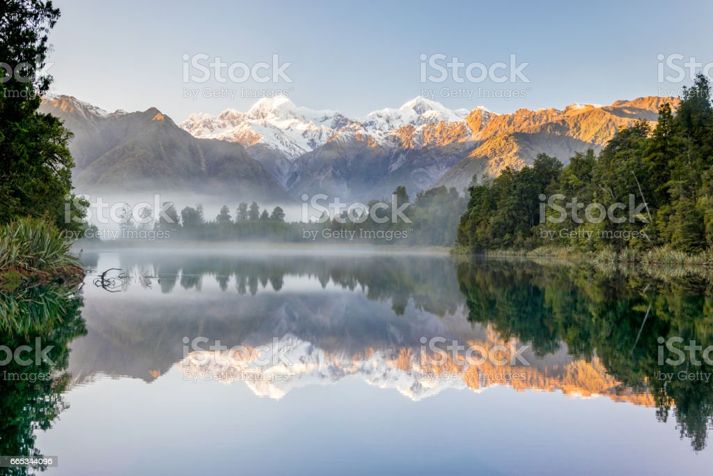 Southern alps with Mount Cook and Mt. Tasman reflected in Lake Mathesson, New Zealand stock photo