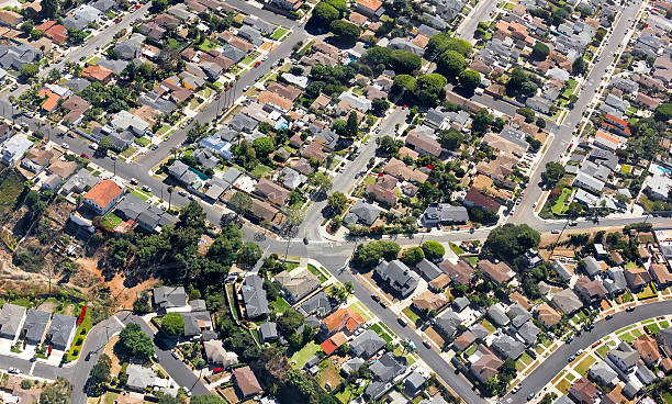 Southern California Suburban Multiple houses are seen from an aerial viewpoint over a residential neighborhood in southern California.   urban sprawl stock pictures, royalty-free photos & images