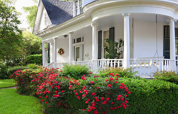 Southern Home with porch Southern Alabama home with beautiful porch and lovely red roses. southern usa stock pictures, royalty-free photos & images