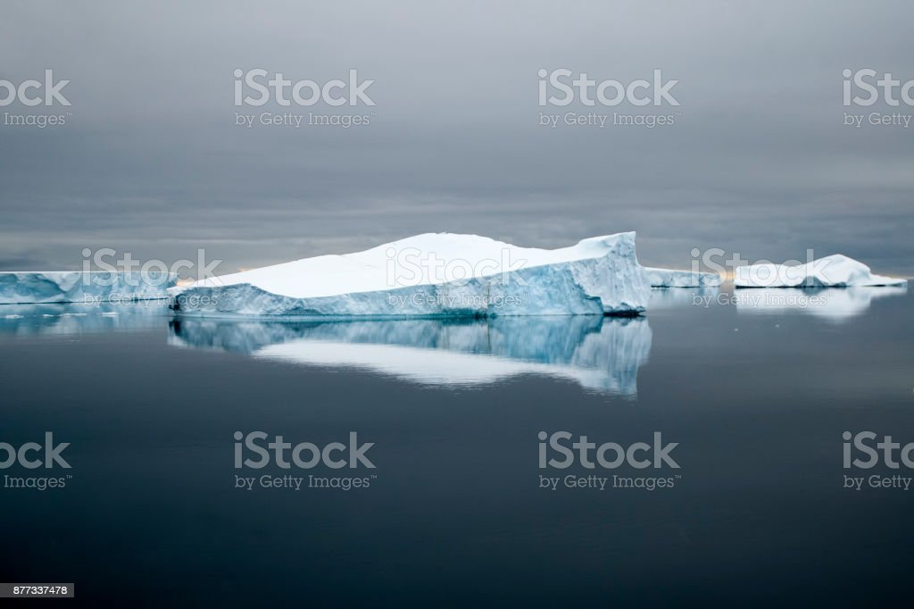 Southern Ocean, iceberg reflections with stormy sky stock photo