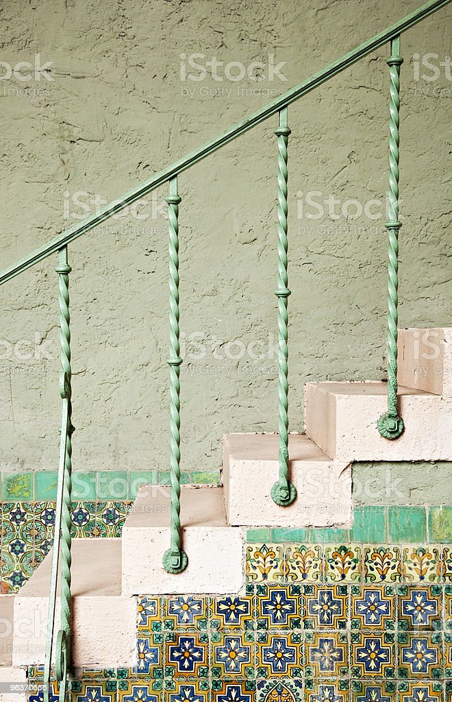 Southern stairways with iron railing and painted tiles stock photo