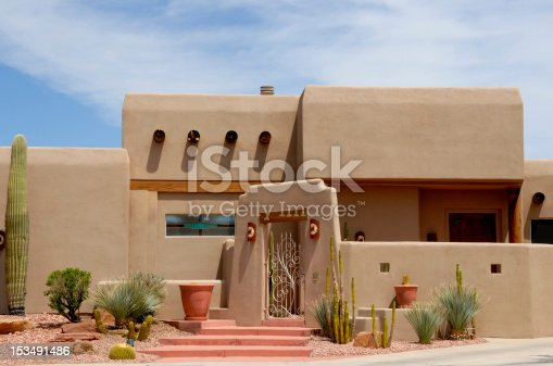 A close up of a nicely landscaped home of the southwest adobe style just outside of Las Vegas, Nevada near the Lake Mead resort.