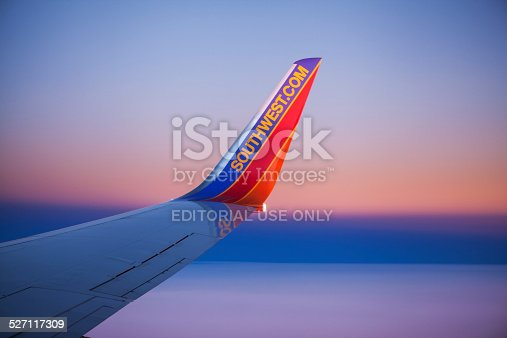 Orlando, Florida, USA - December 2, 2013: A curved winglet with the Southwest.com web site address on the wing of a Boeing 737 airplane operated by Southwest Airlines.
