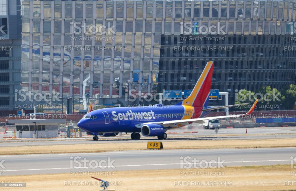 Southwest Airlines Boeing 737800 Taxiing To The End Of The Runway For Departure Stock Photo Download Image Now Istock