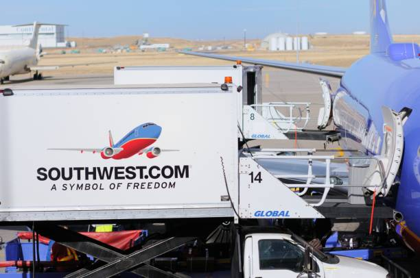Southwest airplane being serviced stock photo