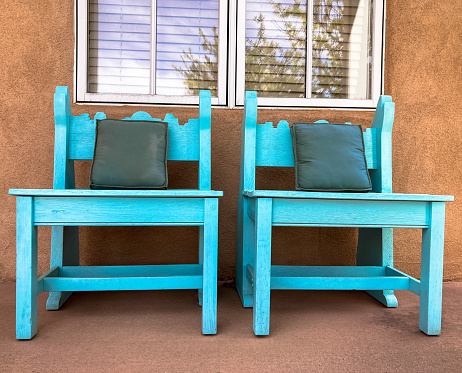 Southwest US Porch with Rustic Turquoise Chairs