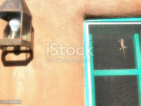 Southwest USA: Adobe House, Turquoise Window, Lizard. Shot in Santa Fe, NM.