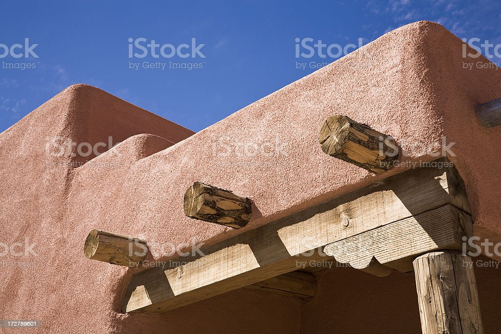 southwestern adobe home roofline and blue sky royalty-free stock photo