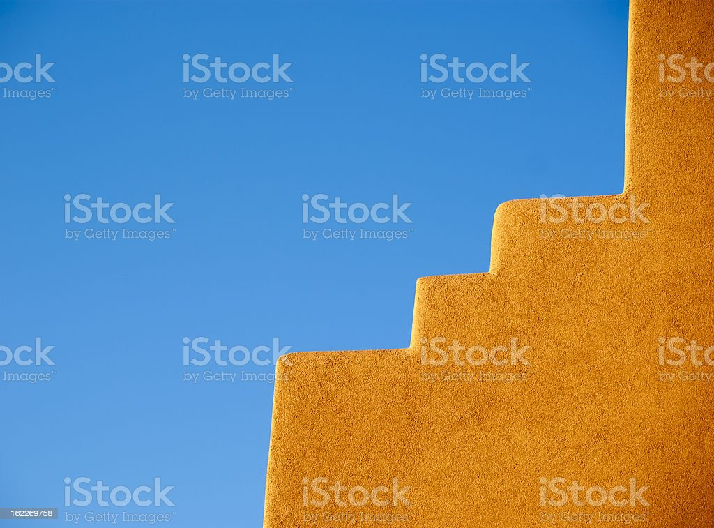 Southwestern Adobe wall and blue sky stock photo
