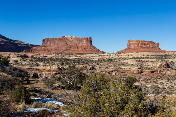 Southwestern Buttes Buttes in the American South West. North of Moab Utah the two monoliths are named for their likeness to two civil war ironclad ships entrada sandstone stock pictures, royalty-free photos & images