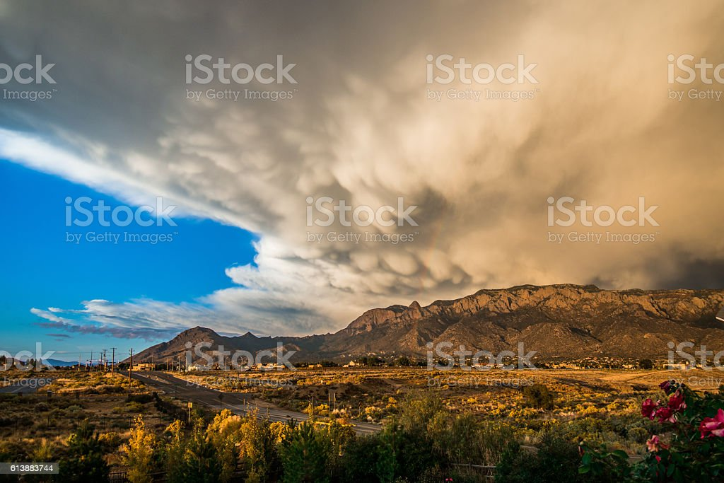 Southwestern Landscape with Sandia Mountains and Dramatic Clouds stock photo