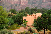 A Santa Fe style home set against the red rocks of Arizona.