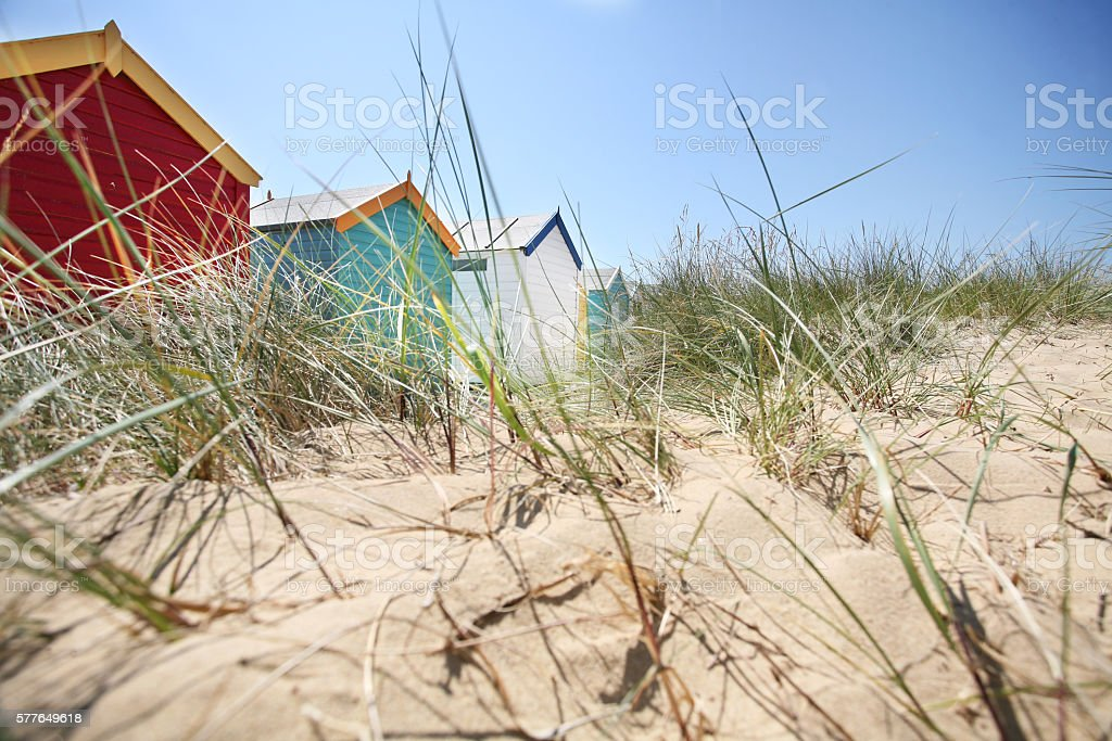 Southwold beach huts and sand dunes stock photo