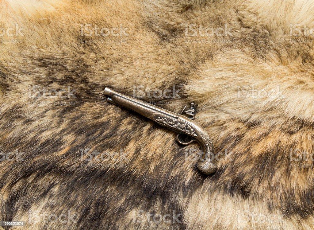 souvenir pistol on the skin royalty-free stock photo