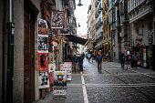 Posters and souvenirs hang outside a store in the old town of Pamplona, Spain. The city is famous for its annual running of the bulls during the festival of San Fermín. (May 30, 2018)