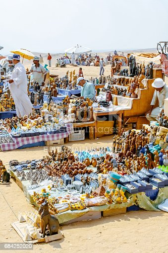 883177796istockphoto Cairo, Egypt - August 13, 2006: Souvenir shops in desert. Giza, Egypt. UNESCO World Heritage 684252020