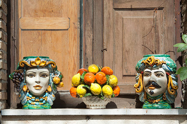 Souvenirs from Sicily Typical ceramic vases and objects of sicilian craftsmanship used as ornaments on a window sill in Castelmola, Sicily sicily stock pictures, royalty-free photos & images