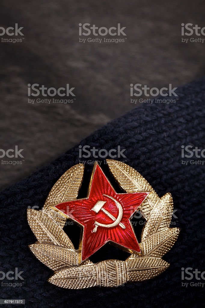 Soviet badge with red star, hammer, sickle and laurel wreath. stock photo