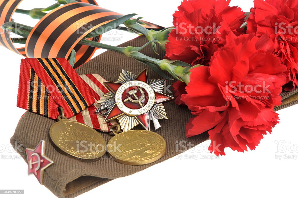 Soviet military cap with red flowers, Saint George ribbon, medal stock photo