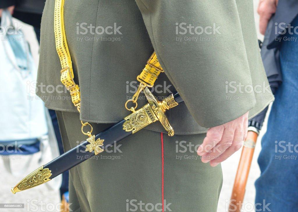 Soviet officer dagger in the hands of veteran in the second world war stock photo