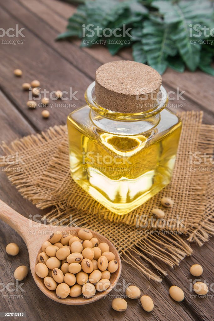 Soy bean and soy oil on wooden table stock photo
