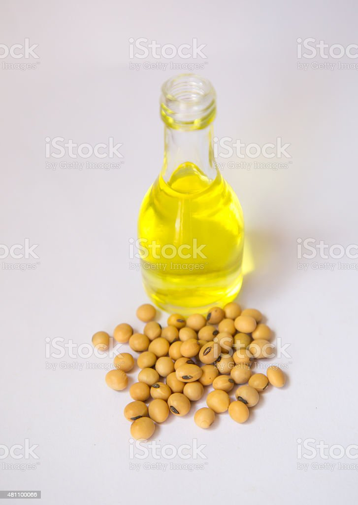 Soy beans and oil bottle stock photo