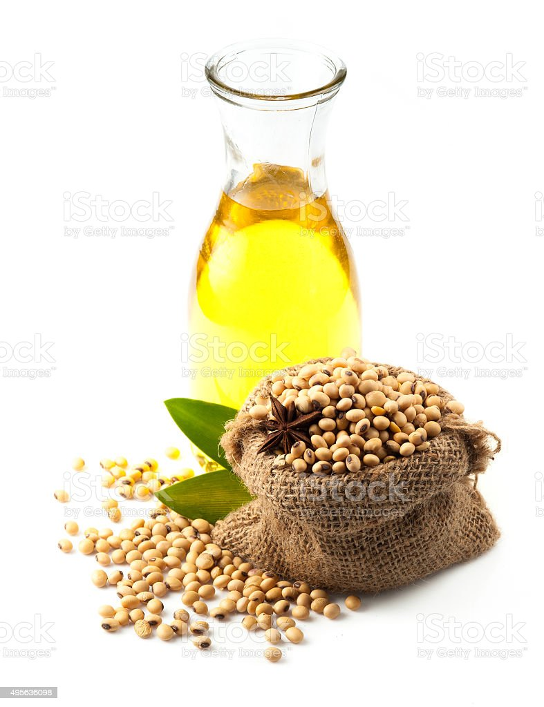 Soy beans and oil on white background stock photo
