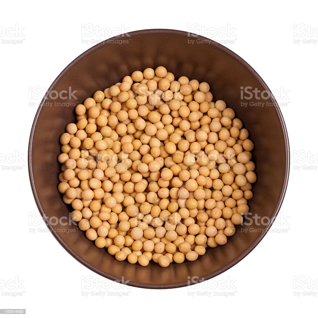 Soy beans inside brown bowl with white background, from top stock photo
