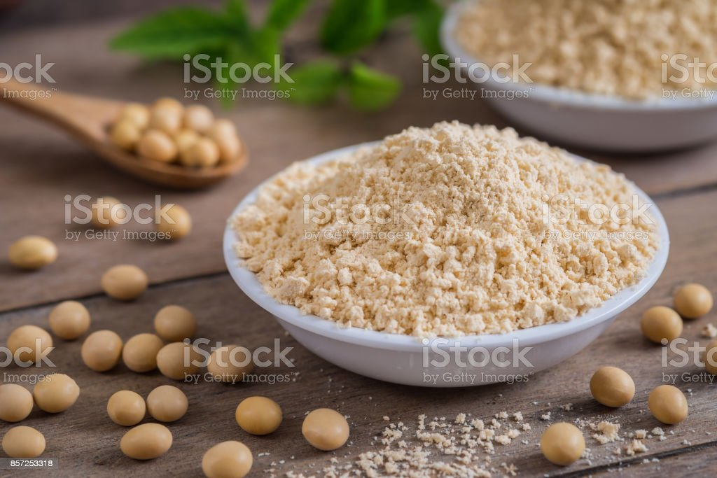 Soy flour in bowl and soybean stock photo