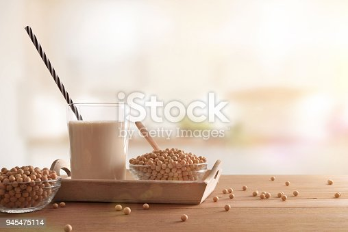 887350996 istock photo Soy milk and grains in white kitchen front 945475114