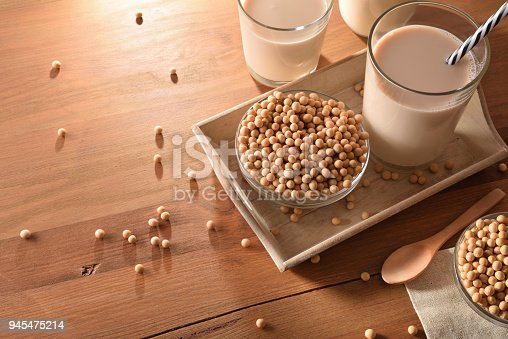 887350996 istock photo Soy milk and grains on wood table 945475214