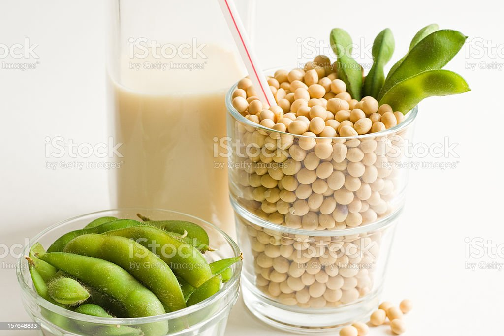 Soy Milk Concept With Glass Filled Full of Loose Soybeans stock photo