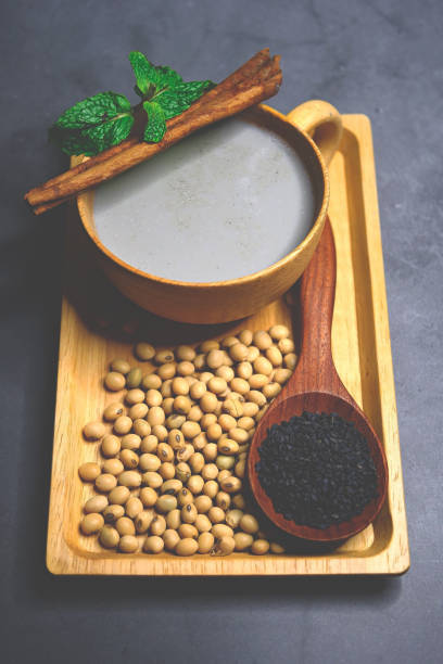 Soy milk mix black sesame with soybean seed and black sesame seeds stock photo