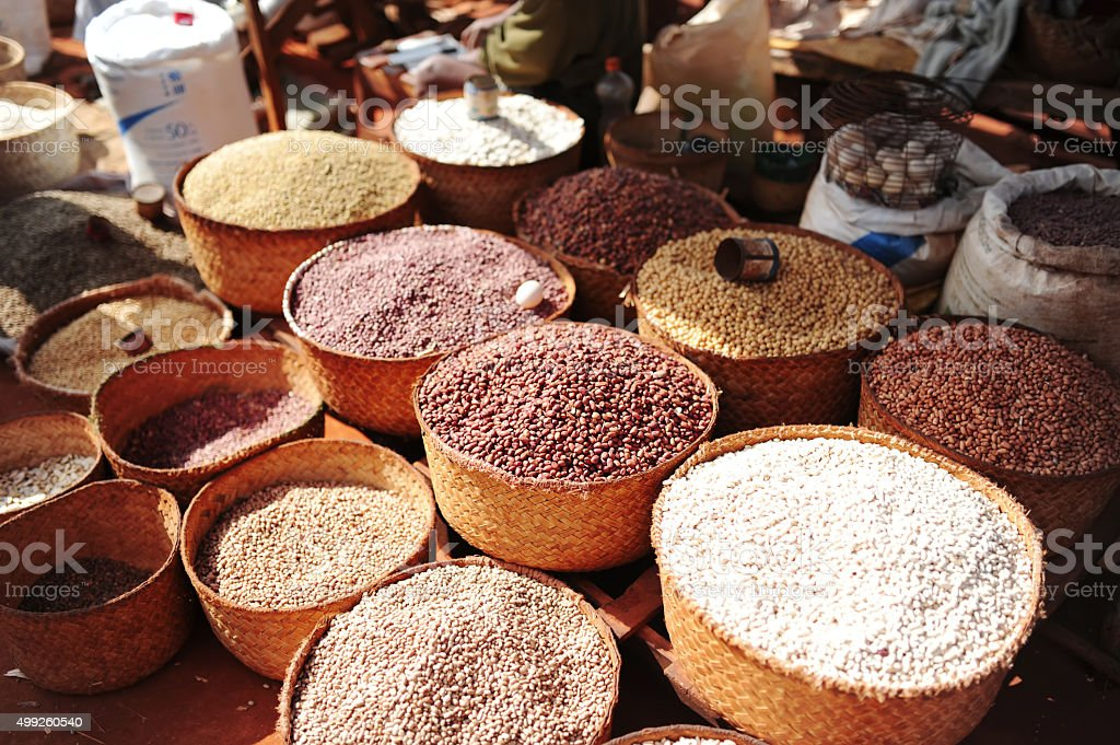 Soy, rice and other plants. City market. Antananarivo stock photo