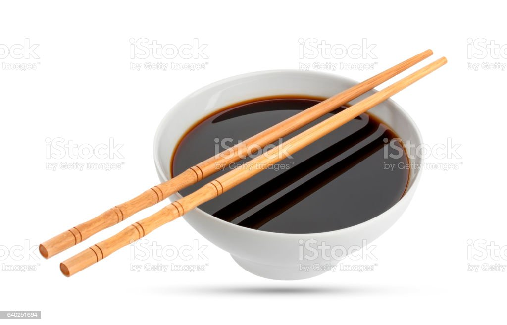 Soy sauce and chopsticks isolated on white stock photo