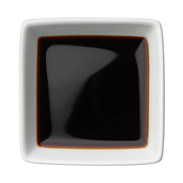 Soy sauce in a square bowl stock photo
