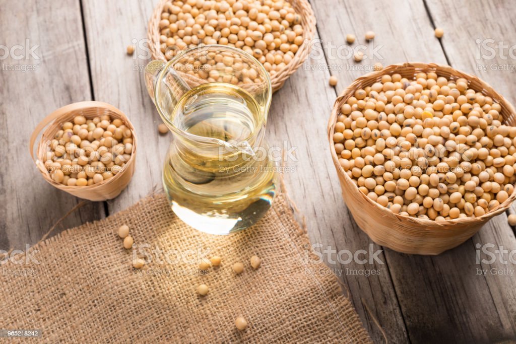 Soybean and soybean oil in jar on wood royalty-free stock photo