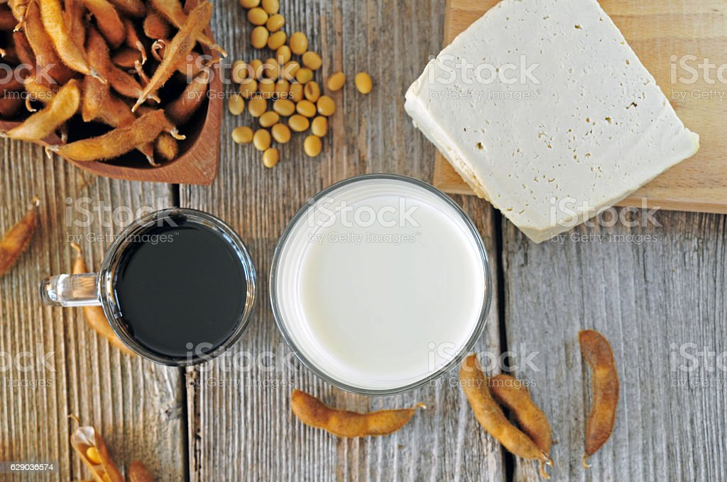 Soybean milk, sauce and tofu on a wooden table stock photo