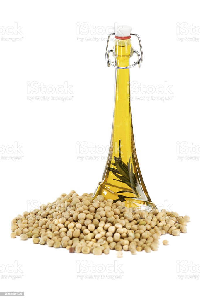 Soybean oil with glass jar and soybeans stock photo