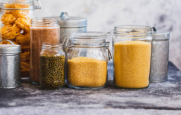 Soybeans, Quinoa, Bulgur And Couscous Cereals In Glass Jars stock photo