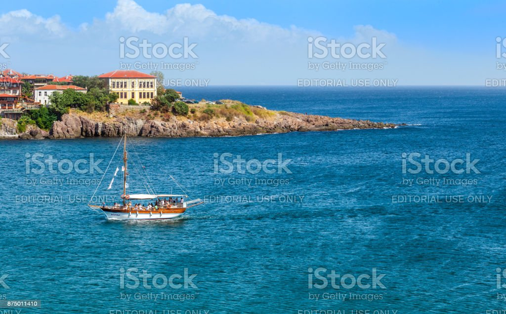 Sozopol town and a ship in the sea. stock photo