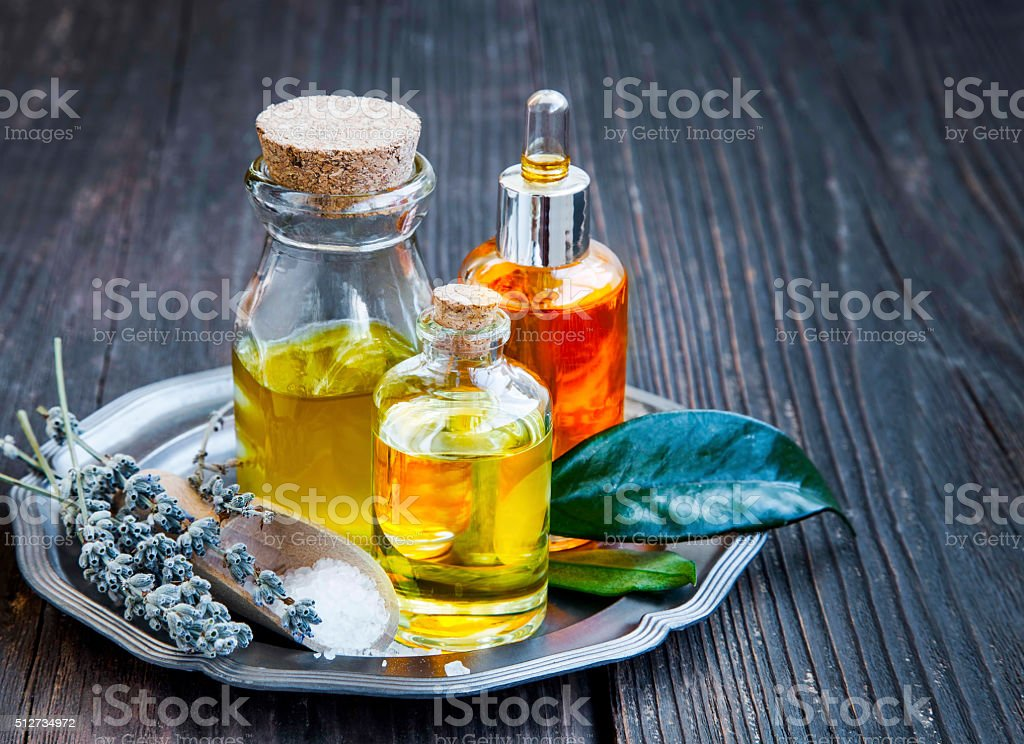 Spa and aromatherapy oils in transparent bottles stock photo