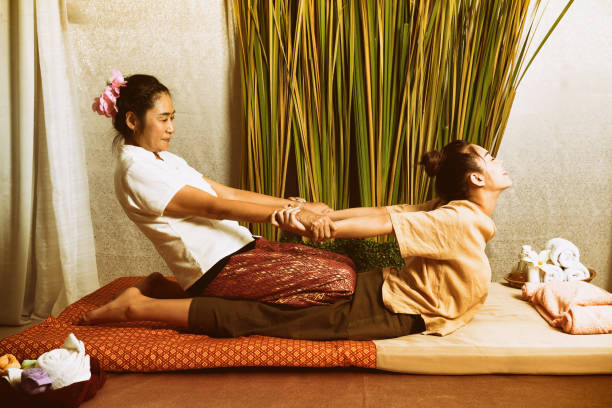 spa and massage : thai massage and spa for healing and relaxation - thai massage stock photos and pictures